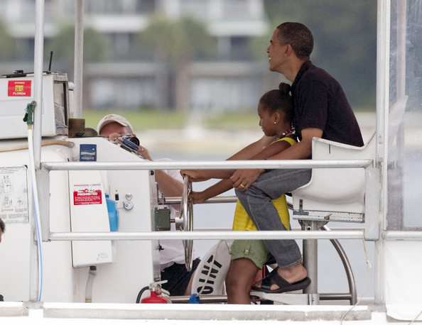 Barack Obama U.S. President Barack Obama and daughter Sasha drive the Bay Point Lady as they go for a boat ride on St Andrews Bay August 15, 2010 In Panama City Beach, Florida. The First Family is visiting the area to help promote tourism and check up on cleanup efforts from the aftermath of the Deepwater Horizon Oil spill.