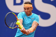 Rafael Nadal of Spain plays a backhand against David Ferrer of Spain during the round of 16 match on day two of the Barcelona Open Banc Sabadell at Real Club De Tenis Barcelona on April 25, 2019 in Barcelona, Spain.
