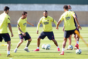 Lionel Messi and Arturo Vidal of FC Barcelona follow the ball during a training session at Ciutat Esportiva Joan Gamper on May 23, 2020 in Barcelona, Spain. Spanish LaLiga clubs are back training in groups of up to 10 players following the LaLiga's 'Return to Training' protocols.