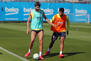 Gerard Pique of FC Barcelona plays the ball under pressure from Ronald Araujo during a training session at Ciutat Esportiva Joan Gamper on May 22, 2020 in Barcelona, Spain. Spanish LaLiga clubs are back training in groups of up to 10 players following the LaLiga's 'Return to Training' protocols.