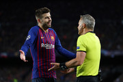 Gerard Pique of Barcelona speaks with Match Referee Bjorn Kuipers during the UEFA Champions League Semi Final first leg match between Barcelona and Liverpool at the Nou Camp on May 01, 2019 in Barcelona, Spain.