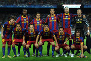 Eric Abidal and Andres Iniesta Photos Photo