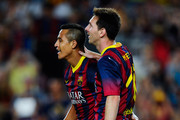 Alexis Sanchez (L) of FC Barcelona celebrates with his team-mate Lionel Messi after scoring his team's third goal during a friendly match between FC Barcelona and Santos at Nou Camp on August 2, 2013 in Barcelona, Spain.