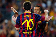 Alexis Sanchez (R) of FC Barcelona celebrates with his team-mate Lionel Messi after scoring his team's third goal during a friendly match between FC Barcelona and Santos at Nou Camp on August 2, 2013 in Barcelona, Spain.