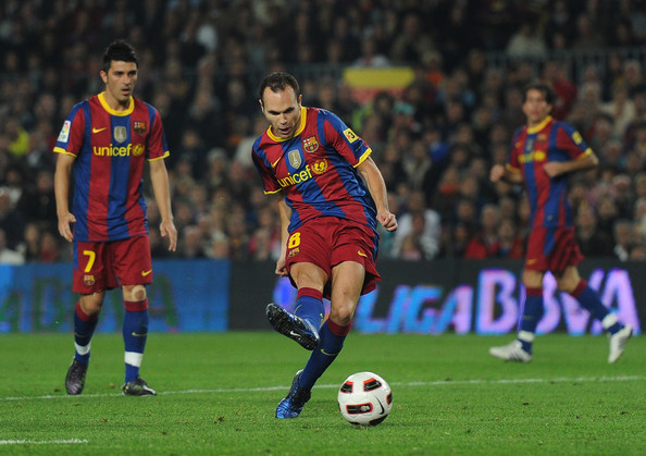 Andres Iniesta of Barcelona scores his sides equalizing goal during the La Liga match between Barcelona and Valencia at the Camp Nou stadium on October 16, 2010 in Barcelona, Spain.
