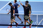 Mike Bryan of the USA and Bob Bryan of the USA (front) celebrate their victory in their men's doubles match against Jamie Murray of Great Britain and John Peers of Australia (back) during day five of the Barclays ATP World Tour Finals at the O2 Arena on November 19, 2015 in London, England.