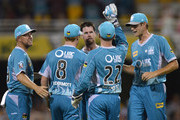 Daniel Christian of the Heat celebrates with team mates after taking the wicket of Shoaib Malik of the Hurricanes during the Big Bash League match between Brisbane Heat and the Hobart Hurricanes at The Gabba on December 28, 2013 in Brisbane, Australia.