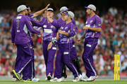 Shoaib Malik of the Hurricanes celebrates with team mates after taking the wicket of Nic Maddinson of the Sixers during the Big Bash League match between the Sydney Sixers and the Hobart Hurricanes at SCG on January 15, 2014 in Sydney, Australia.