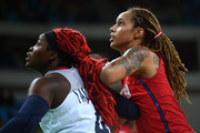 Isabelle Yacoubou #4 of France and Brittney Griner #15 of United States look on during a Women's Semifinal Basketball game between the United States and France at the Carioca Arena on Day 13 of the 2016 Rio Olympic Games on August 18, 2016 in Rio de Janeiro, Brazil.