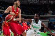 Chamberlain Oguchi #9 of Nigeria pressures Rudy Fernandez #5 of Spain during the Men's Basketball - Preliminary Round Group B Nigeria  vs Spain on Day 6 of the Rio 2016 Olympic Games at Carioca Arena 1 on August 11, 2016 in Rio de Janeiro, Brazil.