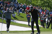 Entertainer Mark Wahlberg and former professional golfer Gary Player of South Africa react to a putt during the Celebrity Shootout of the PGA TOUR Champions Bass Pro Shops Legends of Golf at Big Cedar Lodge on April 28, 2019 in Ridgedale, Missouri.