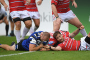 Gloucester player Danny Cipriani (r) cant stop Bath player Tom Dunn going over to score a try during the Gallagher Premiership Rugby match between Bath Rugby and Gloucester Rugby at Recreation Ground on September 8, 2018 in Bath, United Kingdom.