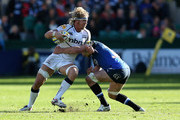 Andy Powell of Sale Sharks is tackled during the Aviva Premiership match between Bath Rugby and Sale Sharks at Recreation Ground on September 29, 2012 in Bath, England.