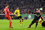 Thomas Mueller of Bayern Muenchen scores his sides second goal during the DFB Cup match between Bayern Muenchen and Borussia Dortmund at Allianz Arena on December 20, 2017 in Munich, Germany.