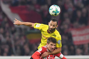 Omer Toprak of Borussia Dortmund wins a header over Thomas Mueller of Bayern Muenchen during the DFB Cup match between Bayern Muenchen and Borussia Dortmund at Allianz Arena on December 20, 2017 in Munich, Germany.