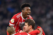 David Alaba of Bayern Muenchen celebrates with his team mates after Thomas Mueller of Bayern Muenchen scores his sides second goal of the game during the DFB Cup match between Bayern Muenchen and Borussia Dortmund at Allianz Arena on December 20, 2017 in Munich, Germany.