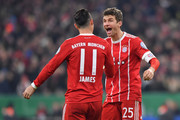 Thomas Mueller of Bayern Muenchen celebrates scoring his teams second goal with teammate James Rodriguez during the DFB Cup match between Bayern Muenchen and Borussia Dortmund at Allianz Arena on December 20, 2017 in Munich, Germany.
