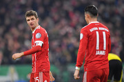 Thomas Mueller of Bayern Muenchen looks at James Rodriguez during the DFB Cup match between Bayern Muenchen and Borussia Dortmund at Allianz Arena on December 20, 2017 in Munich, Germany.