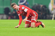 Thomas Mueller of Bayern Muenchen kneels on the pitch during the DFB Cup match between Bayern Muenchen and Borussia Dortmund at Allianz Arena on December 20, 2017 in Munich, Germany.