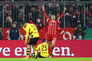 Thomas Mueller of Bayern Muenchen celebrates after scoring his sides second goal during the DFB Cup match between Bayern Muenchen and Borussia Dortmund at Allianz Arena on December 20, 2017 in Munich, Germany.