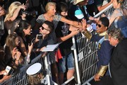 US singer Jermaine Jackson (2ndR) greets fans as he arrives on May 24, 2017 for the screening of the film 'The Beguiled' at the 70th edition of the Cannes Film Festival in Cannes, southern France.  / AFP PHOTO / Anne-Christine POUJOULAT