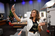 Actress Ciara Renee takes a selfie at the Getty Images Portrait Studio Powered By Samsung Galaxy At Comic-Con International 2015 at Hard Rock Hotel San Diego on July 11, 2015 in San Diego, California.
