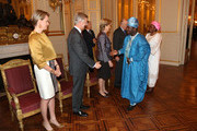 Princess Mathilde, Prince Philippe, Queen Paola and King Albert II of Belgium meet Ambassador of Benin Republic Charles Borromee Todjinou at Palais de Bruxelles on January 9, 2013 in Brussel, Belgium.