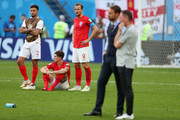 Kyle Walker, John Stones, and Harry Kane of England look dejected as Belgium recieve their third place medals during the 2018 FIFA World Cup Russia 3rd Place Playoff match between Belgium and England at Saint Petersburg Stadium on July 14, 2018 in Saint Petersburg, Russia.