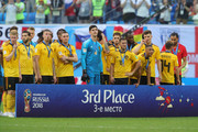 Belgium players pose for a photo after recieving their third place medals during the 2018 FIFA World Cup Russia 3rd Place Playoff match between Belgium and England at Saint Petersburg Stadium on July 14, 2018 in Saint Petersburg, Russia.