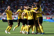 Eden Hazard of Belgium celebrates with teammates after scoring a penalty for his team's first goal during the 2018 FIFA World Cup Russia group G match between Belgium and Tunisia at Spartak Stadium on June 23, 2018 in Moscow, Russia.