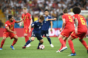 Yuya Osako of Japan is challenged by Nacer Chadli of Belgium during the 2018 FIFA World Cup Russia Round of 16 match between Belgium and Japan at Rostov Arena on July 2, 2018 in Rostov-on-Don, Russia.