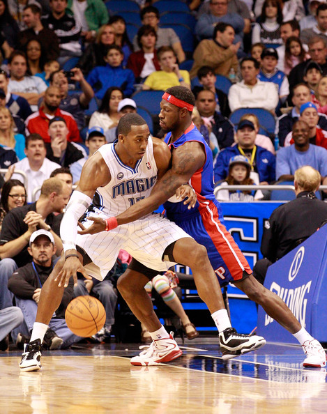 Detroit Pistons v Orlando Magic [sports,basketball moves,basketball player,tournament,basketball court,team sport,ball game,player,basketball,fan,ben wallace 6,user,user,dwight howard,user,note,orlando,detroit pistons,orlando magic,game]