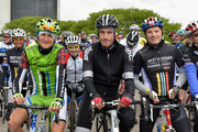 Professional road racing cyclists Ted King (L) and George Hincapie (C) participate in the Best Buddies Challenge: Hyannis Port on May 31, 2014 in Boston, Massachusetts.