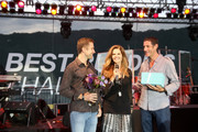 Professional cyclist Christian Vande Velde, Honorary Co-Chair Maria Shriver and professional cyclist George Hincapie speak onstage at the Hearst Ranch Barbeque, Celebration and Concert during the Best Buddies Hearst Castle Challenge at Hearst Ranch on September 12, 2015 in San Simeon, California.