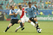 Rodrigo Bentancur and Diego Godin of Uruguay fights for the ball with Paolo Guerrero of Peru during the Copa America Brazil 2019 quarterfinal match between Uruguay and Peru at Arena Fonte Nova on June 29, 2019 in Salvador, Brazil.