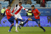 Paolo Guerrero of Peru fights for the ball with Gary Medel and Erick Pulgar of Chile during the Copa America Brazil 2019 Semi Final match between Chile and Peru at Arena do Gremio on July 03, 2019 in Porto Alegre, Brazil.