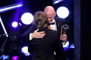 FIFA President, Gianni Infantino (R) presents Luka Modric of Real Madrid with the trophy for The Best FIFA Men's Player 2018 during the The Best FIFA Football Awards Show at Royal Festival Hall on September 24, 2018 in London, England.