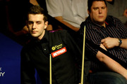 Ronnie O'Sullivan of England and Mark Selby of England line up a shot during their Quarter Final match in the Betfred.com World Snooker Championships, at The Crucible Theatre on April 28, 2010 in Sheffield, England.