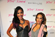(L-R) Julissa Bermudez and Adrienne Bailon attend the Betsey Johnson show during Spring 2013 Mercedes-Benz Fashion Week at Espace on September 11, 2012 in New York City.