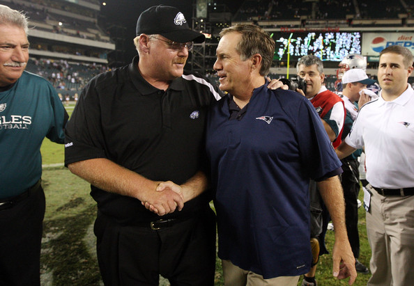 New England Patriots v Philadelphia Eagles [team,event,coach,baseball umpire,t-shirt,competition event,official,stadium,crowd,referee,andy reid,bill belichick,hands,lincoln financial field,philadelphia,pennsylvania,philadelphia eagles,new england patriots,game]