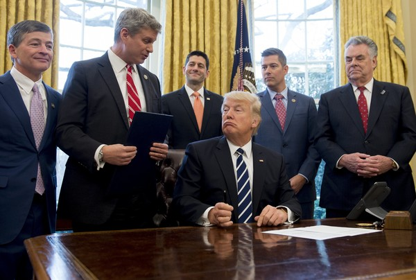President Trump Signs A Resolution Related To Financial Reform [event,businessperson,management,collaboration,business,suit,official,company,government,employment,resolution,reform,trump signs,house joint resolution 41,oil,gas,us,president,donald trump,bill huizenga]