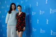(L-R) Actress Ni Jingyang and actress Gwei Lun Mei attend the 'Black Coal, Thin Ice' (Bai Ri Yan Huo) photocall during 64th Berlinale International Film Festival at Grand Hyatt Hotel on February 12, 2014 in Berlin, Germany.