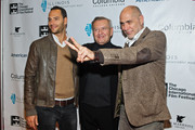 "Producer Lucas Akoskin, Chicago International Film Festival founder Michael Kutza, and Director Guillermo Arriaga attend a screening of ""Words With Gods"" at the AMC River East 21 on October 10, 2014 in Chicago, Illinois."