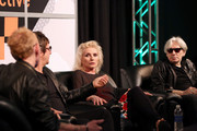 """(L-R) Radio presenter Nic Harcourt and musicians Clem Burke, Debbie Harry, and Chris Stein speak onstage at """"Blondie Panel at SXSW"""" on March 12, 2014 in Austin, Texas, for the documentary Blondie's New York, premiering on Smithsonian Channel."""