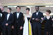 (L-R) Actors Billy Crudup and Noah Emmerich, director Guillaume Canet, actors Clive Owen, Marion Cotillard, Jamie Hector, Lily Taylor and Domenick Lombardozzi attend the 'Blood Ties' Premiere during the 66th Annual Cannes Film Festival at the Palais des Festivals on May 20, 2013 in Cannes, France.