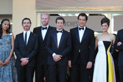 (L-R) Producer Christopher Woodrow, actors Zoe Saldana,  Billy Crudup and Noah Emmerich, director Guillaume Canet, actors Clive Owen, Marion Cotillard, Jamie Hector, Lily Taylor and Domenick Lombardozzi attend the 'Blood Ties' Premiere during the 66th Annual Cannes Film Festival at the Palais des Festivals on May 20, 2013 in Cannes, France.