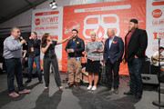 (L-R) Lee Schrager, Mark Pastore, Rachel Ray, Adam Richman, Anne Burrell,  Marc Murphy, Andrew Zimmern, and Nick Mangold appear on stage at the Blue Moon Burger Bash presented by Pat LaFrieda Meats hosted by Rachael Ray during the New York City Wine & Food Festival at Esurance Rooftop Pier 92 on October 17, 2014 in New York City.