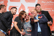 (L-R) Adam Richman, Rachael Ray, Anne Burrell, Andrew Zimmern and Nick Mangold pose onstage at the Blue Moon Burger Bash presented by Pat LaFrieda Meats hosted by Rachael Ray during the New York City Wine & Food Festival at Esurance Rooftop Pier 92 on October 17, 2014 in New York City.