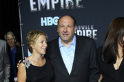 """Actress Edie Falco (L) and actor James Gandolfini attend the premiere of """"Boardwalk Empire"""" at the Ziegfeld Theatre on September 15, 2010 in New York City."""