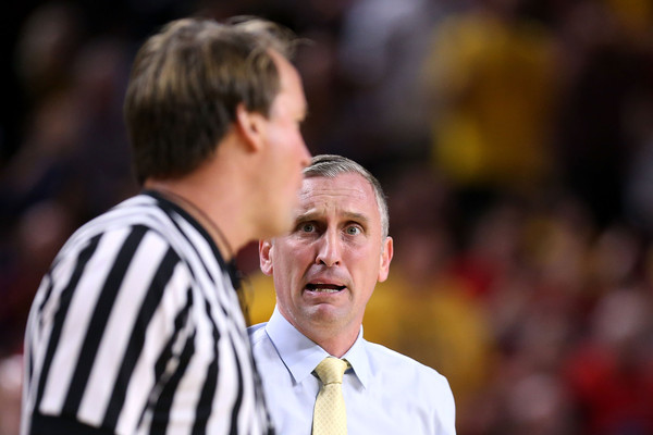Arizona v Arizona State [official,event,referee,championship,competition event,gesture,bobby hurley,john higgins,wells fargo arena,tempe,arizona state,arizona,arizona wildcats,college basketball game,half]